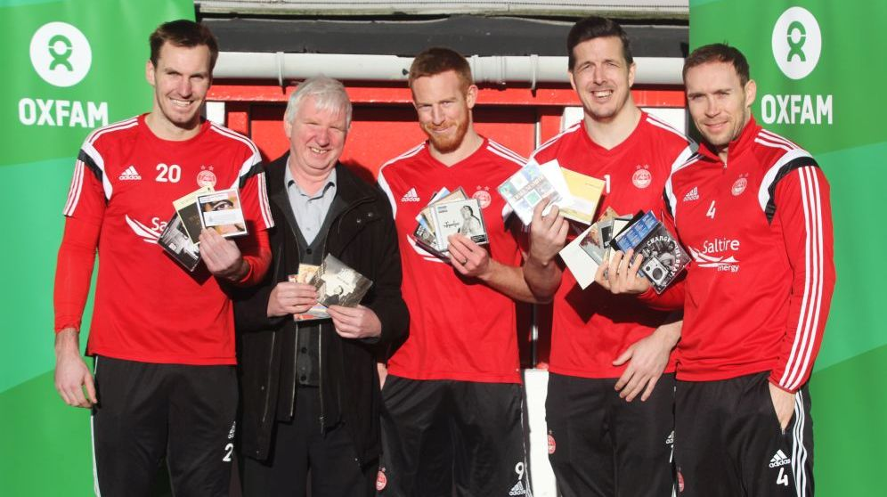Oxfam-Area-Manager-Peter-Roy-who-is-leading-the-initiative-is-pictured-with-Dons-players-Scott-Brown-Adam-Rooney-Jamie-Langfield-and-Russell-Anderson-2