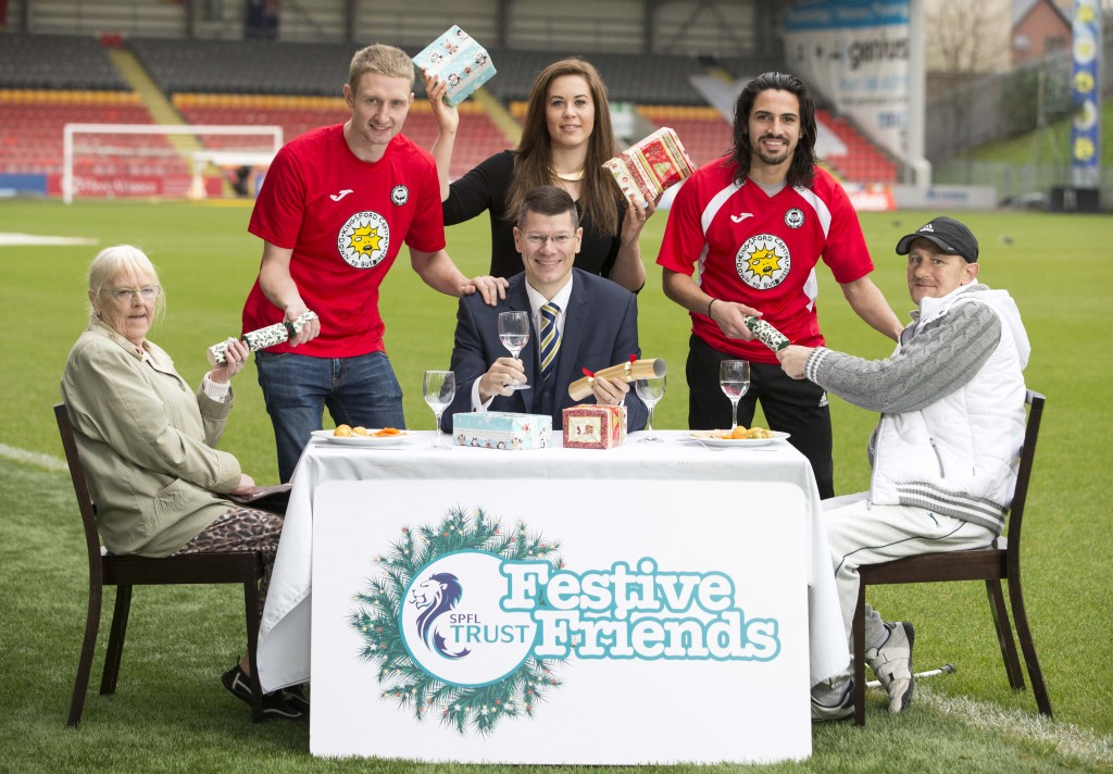 GLASGOW SPFL Trust launches festive friends project which will feed 500 elderly people at christmas... Partick players Chris Erskine (left) and Ryan Edwards (right) join Neil Doncaster Chief Executive SPFL (centre) and locals Ryan and Cathy Macdonald